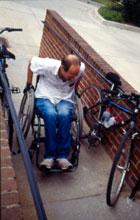 Person in wheelchair using accessibility ramp
