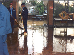 Staff cleaning after a flood